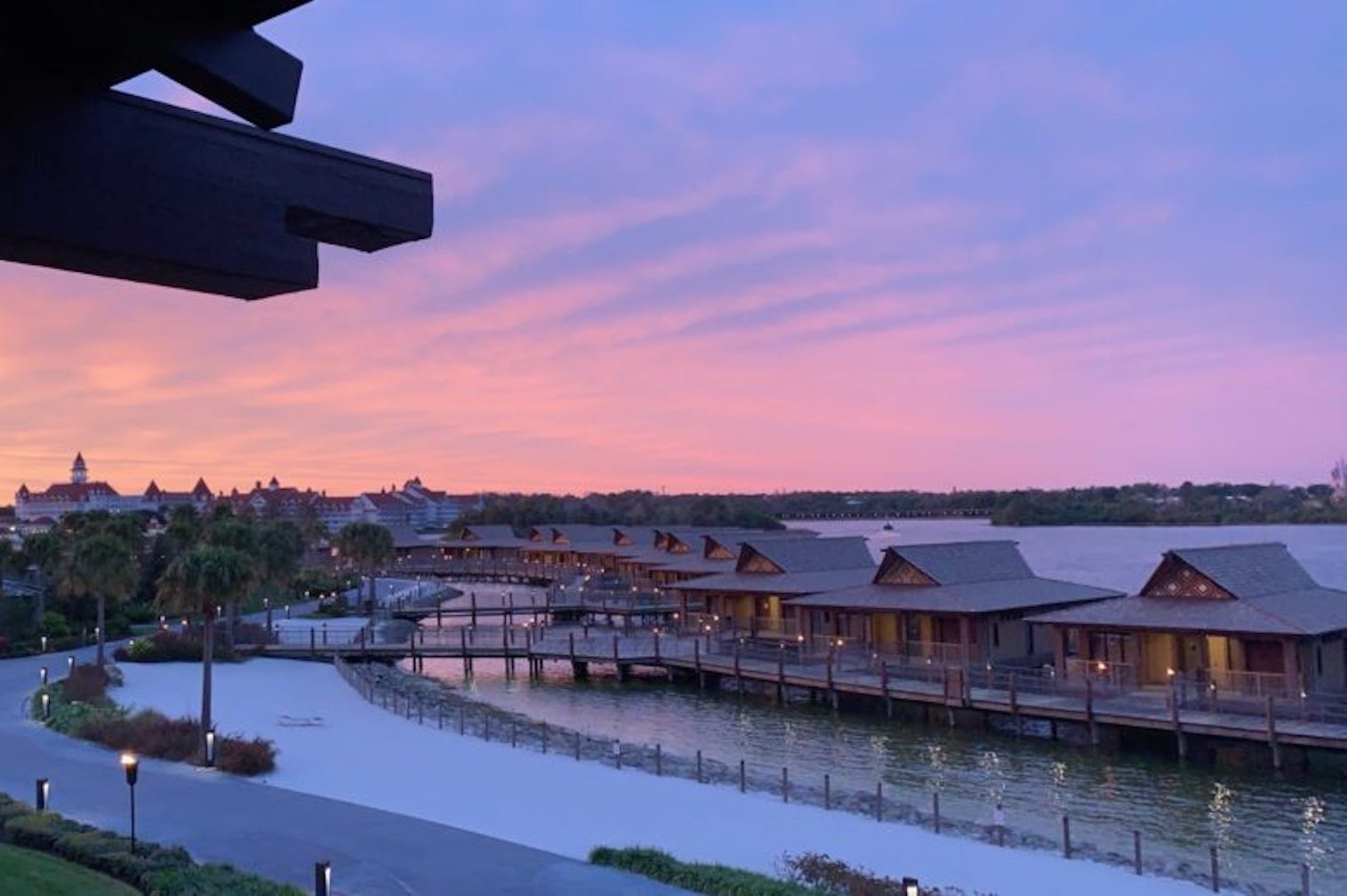 Disney DVC Polynesian view of water bungalows at sunset